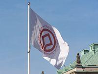 Flagga med världsarvsemblemet